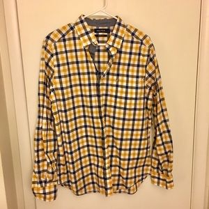 Long-sleeved gold and blue checkered button down